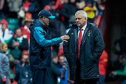 Head Coach Joe Schmidt of Ireland talks to Head Coach Warren Gatland of Wales<br /> <br /> Photographer Simon King/Replay Images<br /> <br /> Six Nations Round 5 - Wales v Ireland - Saturday 16th March 2019 - Principality Stadium - Cardiff<br /> <br /> World Copyright © Replay Images . All rights reserved. info@replayimages.co.uk - http://replayimages.co.uk