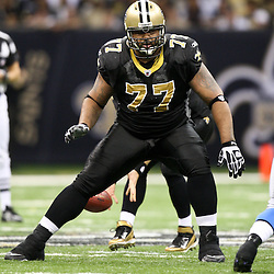 December 4, 2011; New Orleans, LA, USA; New Orleans Saints guard Carl Nicks (77) against the Detroit Lions during a game at the Mercedes-Benz Superdome. The Saints defeated the Lions 31-17. Mandatory Credit: Derick E. Hingle-US PRESSWIRE