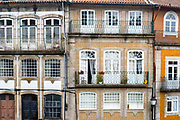 Typical Portuguese architecture - apartments with balconies  in quaint town of Guimaraes in Northern Portugal