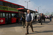 A man yawns while commuters walk southwards over London Bridge, from the City of London - the capital's financial district founded by the Romans in the 1st century - to Southwark on the south bank, on 3rd September 2018, in London, England.