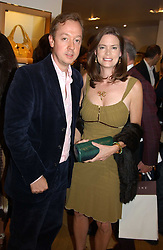 "Editor of Tatler GEORDIE GRIEG and his wife KATHERINE at a book signing hosted by Tod's for Dante Ferretti's new book 'The Art of Production Design"" held at the Tod's store, 2/3 Old Bond Street, London on 19th April 2005.<br />