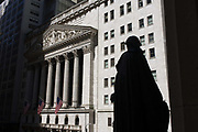 George Washington statue and classical pillars of the New York Stock Exchange (NYSE) on Wall Street, Lower Manhattan. This famous street symbolising the US economy. Wall Street is a 0.7 miles (1.1 km), eight-block-long, street running west to east from Broadway to South Street on the East River in Lower Manhattan in the financial district of New York City. Over time, the term has become a metonym for the financial markets of the United States as a whole, the American financial sector or signifying New York-based financial interests. The NYSE is world's largest stock exchange by market capitalization of its listed companies at US$16.613 trillion as of May 2013. Average daily trading value was approximately US$169 billion in 2013.