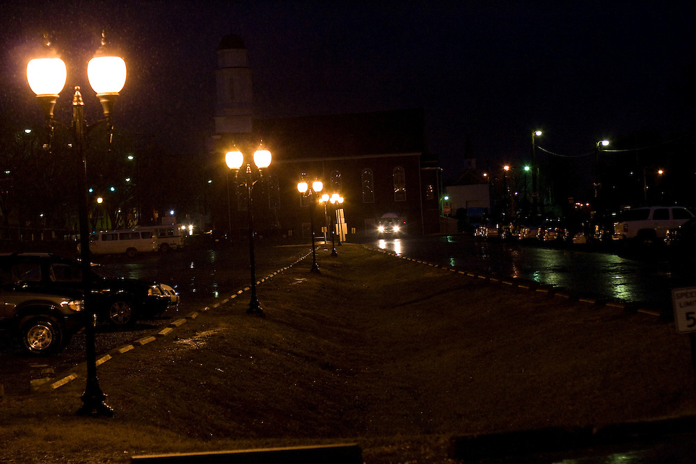 A vehicle pulls into the parking lot of the Charlottesville Railroad Station, before dawn.
