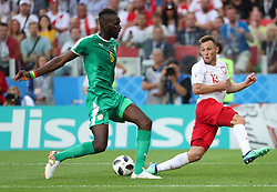 MOSCOW, June 19, 2018  Maciej Rybus (R) of Poland vies with Salif Sane of Senegal during a Group H match between Poland and Senegal at the 2018 FIFA World Cup in Moscow, Russia, June 19, 2018. Senegal won 2-1. (Credit Image: © Ye Pingfan/Xinhua via ZUMA Wire)