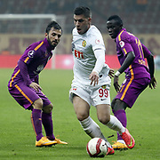 Galatasaray's Emre Colak (L) Armindo Tue Na Bangna (R) and Eskisehirspor's Andac Guleryuz (C) during their Ziraat Turkey CUP soccer match Galatasaray between Eskisehirspor at the AliSamiYen TT Arena at Seyrantepe in Istanbul Turkey on Wednesday, 03 December 2014. Photo by Kurtulus YILMAZ/TURKPIX