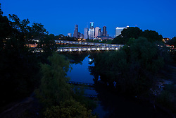 Houston, Texas skyline with Rosemont Bridge over Buffalo Bayou at night.