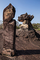 Kou Nang Usa, Thai Stonehenge at Phu Phra Bat - one of the premier attractions in Isaan although its location in rural Udon Thani province keeps the crowds at bay. Large boulders appear to balance on top of impossibly small rocks, rimmed by ancient Buddha images shrouded in legend. Phu Phra Bat combines a beautiful landscape along a forest trail speckled with religious arts going back over 3000 years. The park's huge mushroom shape rock formations were the result of erosion that took place when the terrain was under the sea millions of years ago. Narrow sandstone stems hold up the weight of harder and larger chunks of rock up above them. Similar formations can be seen at Pha Taem national park but those at Phu Phra Bat are more spectacular, as if defying the laws of gravity.  The most haunting set of stones is found at Kou Nang Usa, known as Thai Stonehenge.  Ranging in height from one to three meters, seven markers have stood through the centuries in a circle surrounding a jagged rock formation rising from a broad stone floor.