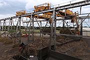 Cranes lift sugar cane bundles at the Belize Sugar Industries Factory, facility that processes all of the BSCFA's sugar cane. Belize Sugar Cane Farmers Association (BSCFA). Belize Sugar Industries Factory, Orange Walk, Belize. January 22, 2013.