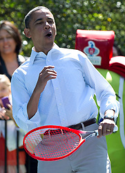 U.S. President Barack Obama reacts as he plays participates in a tennis clinic at the White House Easter Egg Roll on the South Lawn of the White House in Washington, D.C. on April 09, 2012. Photo by Kevin Dietsch/Pool/ABACAPRESS.COM  | 316169_024 Washington Etats-Unis United States