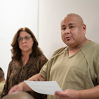 Raymond Becenti is presented with a certificate for graduation from a 28 day substance abuse treatment program at a graduation luncheon at the  McKinley County Jail Wednesday Oct. 3, 2018.