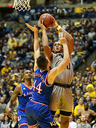 Jan 15, 2018; Morgantown, WV, USA; West Virginia Mountaineers forward Sagaba Konate (50) shoots in the lane during the second half against the Kansas Jayhawks at WVU Coliseum. Mandatory Credit: Ben Queen-USA TODAY Sports