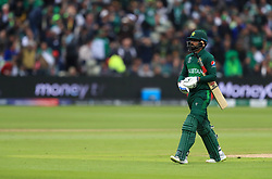 Pakistan's Mohammad Hafeez walks off after being dismissed during the ICC Cricket World Cup group stage match at Edgbaston, Birmingham.