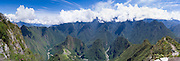 A 180 degree view of the Incan ruins of Machu Picchu and the small mountain, Huayna Picchu, photographed from atop Montaña Machu Picchu, near Aguas Calientes, Peru. Aguas Calientes is in the river valley as the river curves out of view on the right.