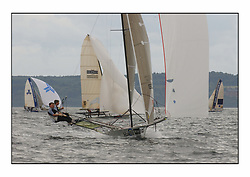 The 2004 Skiff Nationals at Largs held by the SSI.<br /> Andy Richards, Andy Fairlie and Dave Richards onboard Radii.<br /> <br /> <br /> Marc Turner / PFM Pictures