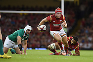Tyler Morgan of Wales breaks away from Ireland's Rory Best (l) . Wales v Ireland rugby union international, RWC warm up friendly match at the Millennium Stadium in Cardiff, South Wales on Saturday 8th August  2015.<br /> pic by Andrew Orchard, Andrew Orchard sports photography.
