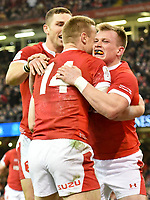 Rugby Union - 2020 Six Nations Championship - Wales vs. Italy<br /> <br /> Nick Tompkins of Wales celebrates scoring with Johnny McNicholl of Wales  & George North of Wales, at the Principality (Millennium) Stadium.<br /> <br /> COLORSPORT/WINSTON BYNORTH
