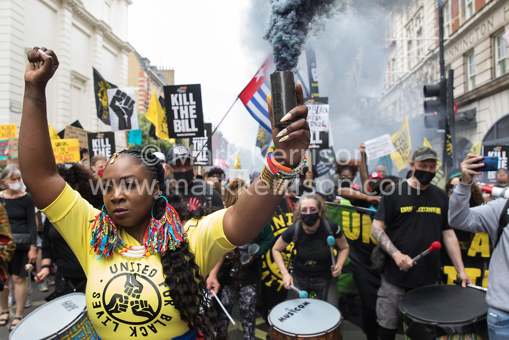 London, UK. 29th May, 2021. Marvina Newton, founder of United for Black Lives, holds aloft a smoke grenade during a Kill The Bill National Day of Action in protest against the Police, Crime, Sentencing and Courts (PCSC) Bill 2021. The PCSC Bill would grant the police a range of new discretionary powers to shut down protests, including the ability to impose conditions on any protest deemed to be disruptive to the local community, wider stop and search powers and sentences of up to 10 years in prison for damaging memorials.
