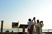 Deacon Leonard Richardson (L) and Pastor Tom Jackson, O.P., celebrate a sunrise mass at Rainbow Beach on Chicago's south side to pray for peace and non-violence during the upcoming school year. The event hosted by The Black Catholic Deacons in the Archdiocese of Chicago is one of six simultaneous masses along Chicago's lakefront. August 25, 2012 l Brian J. Morowczynski~ViaPhotos...For use in a single edition of Catholic New World Publications, Archdiocese of Chicago. Further use and/or distribution may be negotiated separately. Contact ViaPhotos at 708-602-0449 or email brian@viaphotos.com.