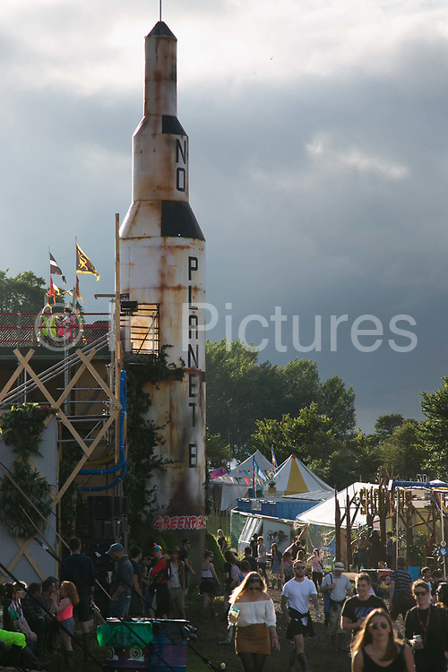 The Greenpeace field with their iconic No Planet B rocket at the Glastonbury Festival 22th July 2016, Somerset, United Kingdom.  Greenpeace had their own venue and field at the festival and the theme this year was how to make a sustainable society in the future . The Glastonbury Festival runs over 3 days and has 3000 acts, including music, art and performance and approx. 150.000 attend the anual event.