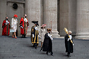 William Russell, the 692nd Lord Mayor of London in guilded overcoat, centre and official dignitaries descend the steps of St Pauls Cathedral after the private The Lord Mayors Service of Reconciliation And Hope function, on 22nd June 2021, in London, England.