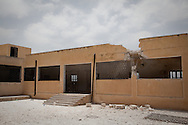 A destroyed school in the town of Lejj, in Syria's north-western Idlib province. The area has been extensively shelled and raided by the Syrian Army and pro-government Shabiha militias in recent months.