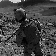"""Alexander The Great invasion route to Kandahar <br /> Sep 09, 2009 - Golestan, Farah Province, Afghanistan - US Marines from the 2nd MEB of the 2/3 Marines patrol the mountains of the Black Pass after fighting the previous night. This is located by the Buji Bast Pass (aka Bhuji Bast) and """"Fighting Mountain"""" aka """"Kohe Tengay"""" which in Pashto means """"Three Kings""""  in Golestan, Farah Province, where US Marines have been deadlocked in a bitter counterinsurgency campaign and conflict with insurgents using mainly Improvise Explosive Devices (IED's)..(Credit Image: © Louie Palu/ZUMA Press)"""