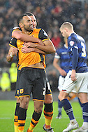 Hull City midfielder Ahmed Elmohamady and Jake Livermore of Hull City celebrate Hull City striker Chuba Akpom scoring for hull  during the Sky Bet Championship match between Hull City and Bolton Wanderers at the KC Stadium, Kingston upon Hull, England on 12 December 2015. Photo by Ian Lyall.