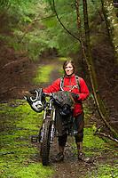 Mountain biking on a wet day along the Oregon Coast. Nehalem, OR