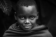 Local boy full of life, innocence and joy in Bwindi, Uganda.