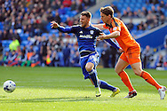 Cardiff City's Anthony Pilkington (l) is challenged by Ipswich's Christophe Berra (r). Skybet football league championship match, Cardiff city v Ipswich Town at the Cardiff city stadium in Cardiff, South Wales on Saturday 12th March 2016.<br /> pic by Carl Robertson, Andrew Orchard sports photography.