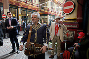 City workers and patriotic public celebrate England's national day in the undervover Leadenhall Market in the City of London, on England's national St George's Day the 23rd April,