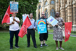 Unite members holding placards and flags prepare to march with NHS workers from the grassroots NHSPay15 campaign from opposite Parliament to 10 Downing Street with a petition signed by over 800,000 people calling for a 15% pay rise for NHS workers on 20th July 2021 in London, United Kingdom. At the time of presentation of the petition, the government was believed to be preparing to offer NHS workers a 3% pay rise in 'recognition of the unique impact of the pandemic on the NHS'.
