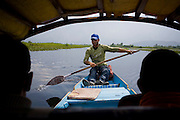 A Kashmiri shikara boater ferries his passengers across the lake. Travel photographs of Srinagar, Kashmir, Jammu & Kashmir, India on 8th June 2009.  Photo by Suzanne Lee /  For The National