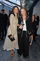 Left to right, DAME NATALIE MASSENET and ANYA HINDMARCH at British Vogue's Centenary Gala Dinner in Kensington Gardens, London on 23rd May 2016.