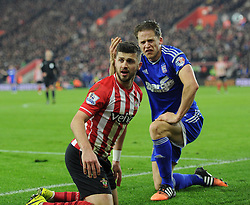Ipswich Town's Christophe Berra remonstrates with Southampton's Shane Long after fouling the Saint's striker - Photo mandatory by-line: Paul Knight/JMP - Mobile: 07966 386802 - 04/01/2015 - SPORT - Football - Southampton - St Mary's Stadium - Southampton v Ipswich Town - FA Cup Third Round