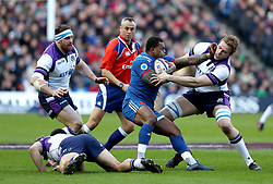 France's Virimi Vakatawa (centre) is tackled by Scotland's Jonny Gray (right) during the NatWest 6 Nations match at BT Murrayfield, Edinburgh.