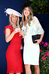 Racegoers Lauren Roth-Brown (left) and Jenny Wren (right) during day five of Royal Ascot at Ascot Racecourse.