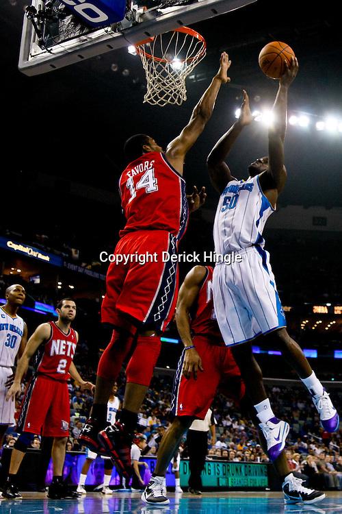 December 22, 2010; New Orleans, LA, USA; New Orleans Hornets center Emeka Okafor (50) shoots over New Jersey Nets power forward Derrick Favors (14) during a game at the New Orleans Arena. The Hornets defeated the Nets 105-91. Mandatory Credit: Derick E. Hingle