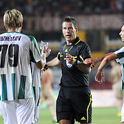 Referee's Mark CLATTENBURG (C) and Karpaty's Igor KHUDOBYAK (R) during their UEFA Europa League Play-Offs First Leg soccer match Galatasaray between Karpaty at AliSamiYen stadium at Istanbul in Turkey on Thursday, August 19 2010. Photo by TURKPIX
