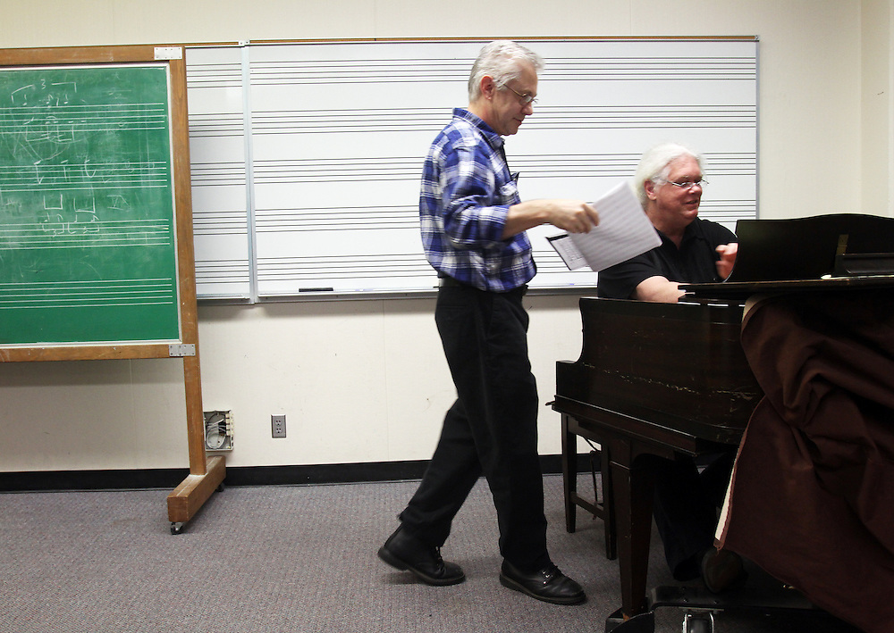 To grade his music students' finals, Marshall Tuttle plays their compositions in front of them on Monday, Dec. 12, 2011. No pressure! Here, Patrick Nearing hands his composition to be judged at Mt. Hood Community College in Gresham.