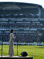 National Hunt Horse Racing - 2019 Randox Health Grand National Festival - Saturday, Day Three (Grand National Day)<br /> <br /> Laura Wright sings the National Anthem in front of the grandstands before   the 17:15 Randox Health Grand National Handicap Chase (Grade 3, Class 1), at Aintree Racecourse.<br /> .<br /> <br /> COLORSPORT/WINSTON BYNORTH