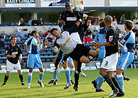 Photo: Frances Leader.<br />Wycombe Wanderers v Chester City. Coca Cola League 2.<br />01/10/2005.<br /><br />Chester's Marcus Richardson tries to head the ball into goal but is stopped by Wycombe's goalie Frank Talia