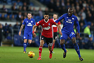 Kevin Bru of Ipswich Town gets the ball ahead of Sol Bamba of Cardiff City (r). EFL Skybet championship match, Cardiff city v Ipswich Town at the Cardiff city stadium in Cardiff, South Wales on Tuesday 31st October 2017.<br /> pic by Andrew Orchard, Andrew Orchard sports photography.