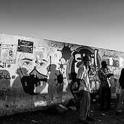 Street murals raising awareness of COVID-19 adorn an area used as a bus stop in Khartoum, Sudan on December 17, 2020.  The International Monetary Fund says that the Sudanese economy contracted by 2.5% in 2019, and GDP is expected to decline even more sharply in 2020, after being hit hard by the Covid-19 pandemic. Two years after a revolution gave way to the end of Omar al-Bashir's 30-year rule, the new government inherited a bankrupt state, burdened by the consequences of international sanctions. Although assisted by the World Bank and the IMF, the country remains mired in the economic crisis.  Byron Smith for Libération