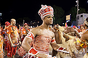 Man wearing costume and crown for Salgueiro Samba School from the Special Group, practices their Carnival procession in the Sambadrome, Rio de Janeiro, Brazil