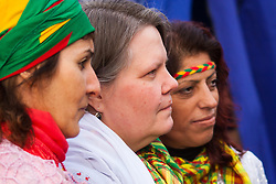sbury Park, London, March 22 2015. Thousands of London's Kurdish community gather for Newroz, their traditional New year's celebrations. The exiled community mourns the death of Londoner and ex Royal Marine Erik Konstandinos Scurfield, a hero to them, who was killed fighting ISIS, and whose mother Vasiliki Scurfield addressed the crowd. PICTURED: Vasiliki Scurfied poses for pictures with members of the Kurdish community, many of whom wanted to be photographed with her.
