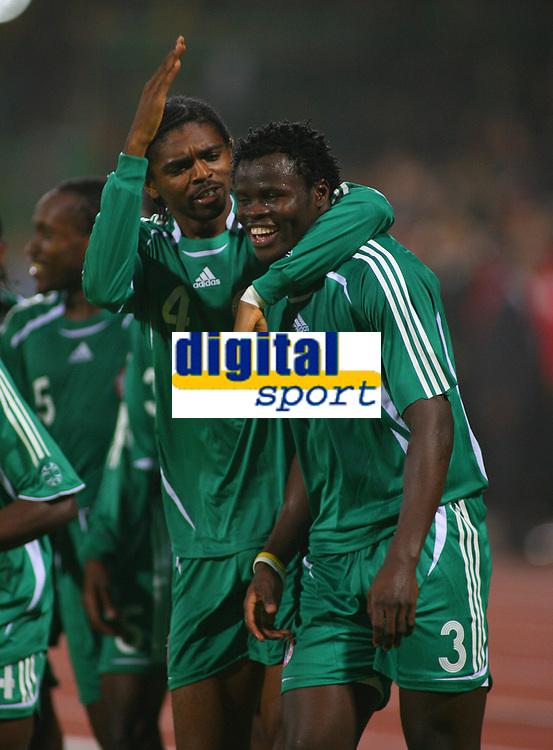 Ismaila Taiwo Taye Celebrates Scoring winning goal with Team Mate Nwankwo Kanu<br />Nigeria 2005/06<br />25th MTN Africa Cup Of Nations Egypt 2006<br />Nigeria v Ghana 23/01/06<br />Photo Robin Parker Fotosports International