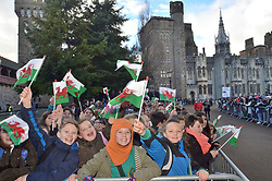 ©Licenced to London News Pictures. 18/01/2018. Cardiff, Wales, UK. Crowds including children from local schools gather at Cardiff Castle wait for Prince Harry and Meghan Markle on their first official visit to Wales since announcing their engagement. The prince and his intended will tour a cultural festival at the historic site. Photo credit IAN HOMER/LNP