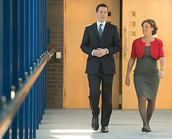 © Licensed to London News Pictures. 30/09/2014. Birmingham, UK. Checellor George Osborne with Rebecca Powell PCC Taunton. The Conservative Party Conference in Birmingham 30th September 2014. Photo credit : Stephen Simpson/LNP
