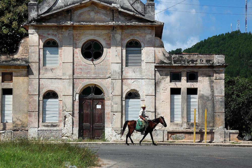 Horse passing an old church in San Miguel de los Banos, Matanzas Province, Cuba.
